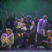 The Emcee (Joseph Anthony Byrd, center, seated) and the boys and girls of the Kit Kat Klub in Paramount Theatre's Cabaret. Photo credit: Liz Lauren